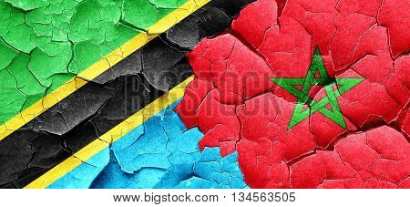 Tanzanian flag with Morocco flag on a grunge cracked wall