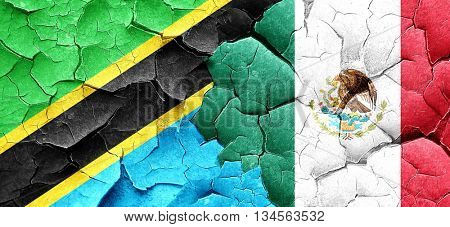 Tanzanian flag with Mexico flag on a grunge cracked wall