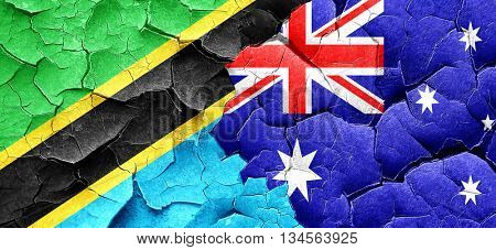 Tanzanian flag with Australia flag on a grunge cracked wall
