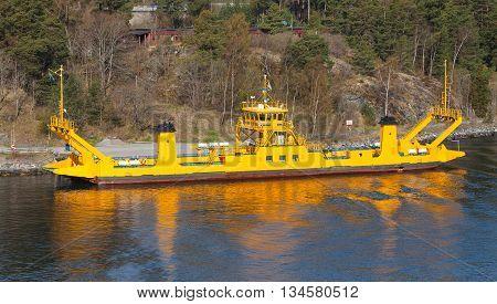Yellow Roro Cargo Ship Goes Near An Island
