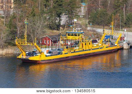 Swedish Yellow Ro-ro Cargo Ship Loading