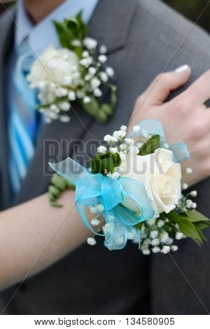 Hand with Corsage flowers boy girl celebration prom marriage wedding