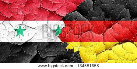 Syria flag with Germany flag on a grunge cracked walla