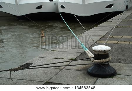stock pictures of ships moored in a harbor with lines
