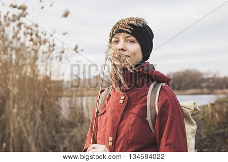 beautiful happy girl near a lake in nature with a cane in his hand, harmonious sensations. traveler girl enjoying life and meditates. poster