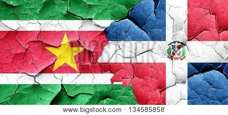 Suriname flag with Dominican Republic flag on a grunge cracked w