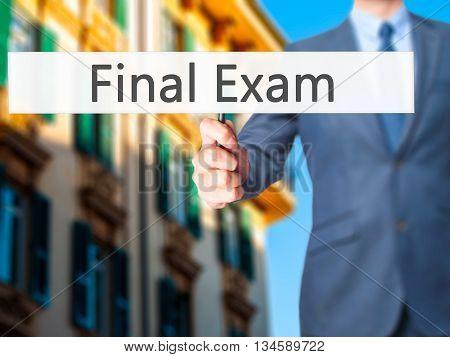Final Exam - Businessman Hand Holding Sign