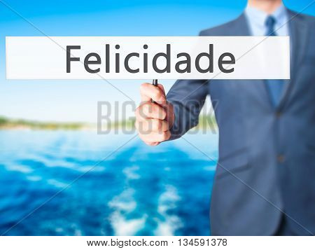 Felicidade (happiness In Portuguese) - Businessman Hand Holding Sign