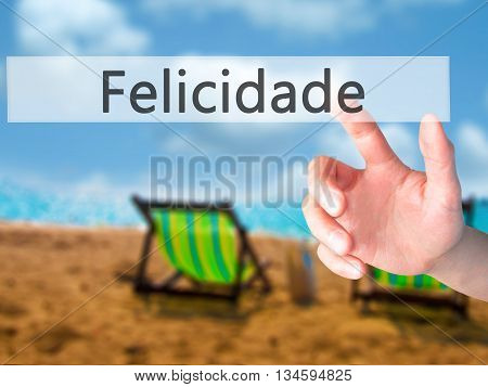 Felicidade (happiness In Portuguese) - Hand Pressing A Button On Blurred Background Concept On Visua