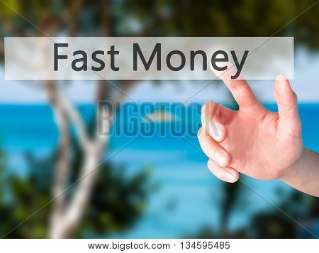 Fast Money - Hand Pressing A Button On Blurred Background Concept On Visual Screen.