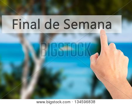 Final De Semana (in Portuguese - Weekend) - Hand Pressing A Button On Blurred Background Concept On