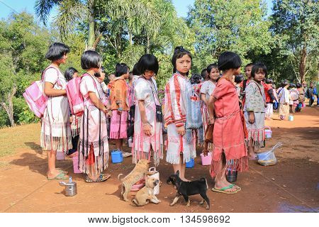 Tak Thailand-Jan 15: Karen children stand in line at border primary scool on Jan 15 2015 in Tha Song Yang Tak Thailand. School located in mountain near Thailand-Myanmar border for help and teach Ethnics children