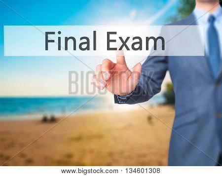 Final Exam - Businessman Hand Pressing Button On Touch Screen Interface.
