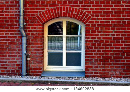 old basement window with bricks in berlin