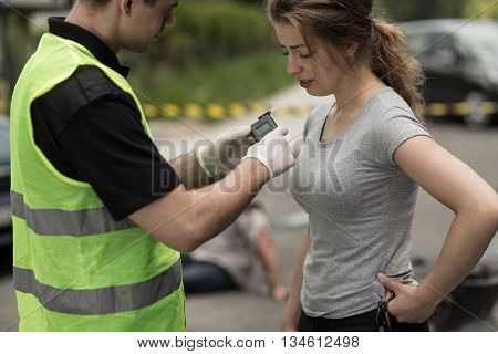 Accident Perpetrator During Breathalyzer Test