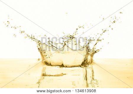 white wine splashing on white background