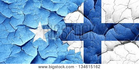Somalia flag with Finland flag on a grunge cracked wall