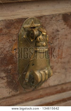 Door handle with human hand and David star