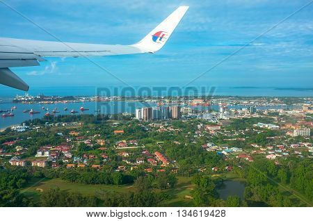 Labuan,Malaysia-March 5,2015 : Aerial view of the Labuan from Malaysia Airlines Boeing 737-800 over Labuan FT.Labuan is an international financial centre, and Malaysia's only deep water anchorage.