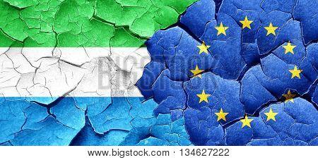 Sierra Leone flag with european union flag on a grunge cracked w
