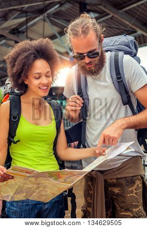 Young beautiful happy couple looking on touristic map in Belgrade