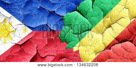 Philippines flag with congo flag on a grunge cracked wall