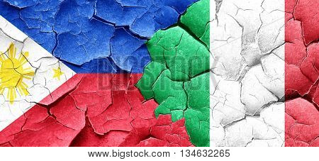 Philippines flag with Italy flag on a grunge cracked wall