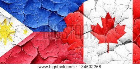 Philippines flag with Canada flag on a grunge cracked wall