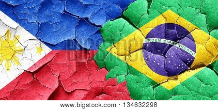 Philippines flag with Brazil flag on a grunge cracked wall