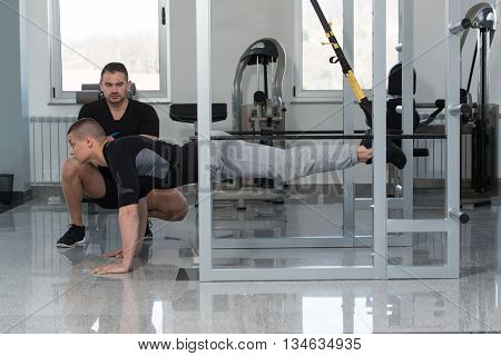 Man With Personal Trainer Train Trx Fitness Straps