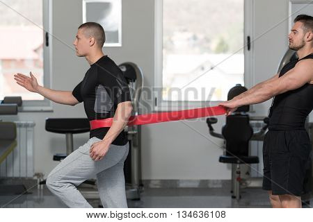Guys Train Together With Resistance Bands