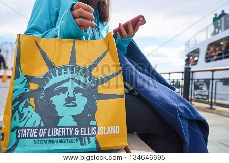 NEW YORK - CIRCA MARCH, 2016: close up shot of paper bag with a picture of the Statue of Liberty. The Statue of Liberty is a colossal neoclassical sculpture on Liberty Island in New York Harbor.