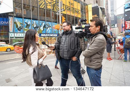 NEW YORK - CIRCA MARCH, 2016: journalist with microphone interviewing woman on street of New York. The City of New York is the most populous city in the United States