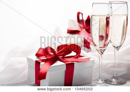 Gift decorated with bow, glass wine