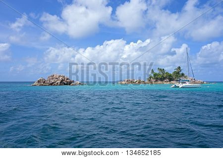 two small Seychelles islands and yacht nearby