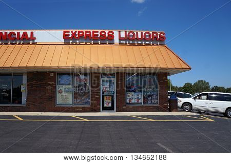 SHOREWOOD, ILLINOIS / UNITED STATES - AUGUST 21, 2015: One may purchase liquor at Express Liquors, in a Shorewood strip mall.