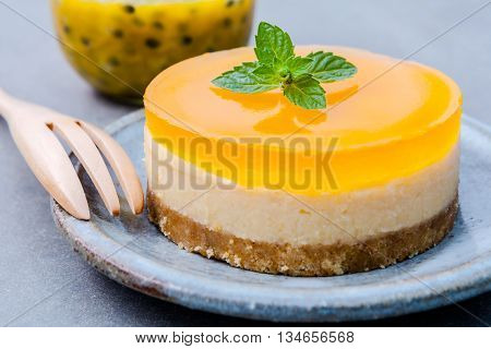 Passion Fruit Cheesecake With Fresh Mint Leaves On Dark Background. Passion Fruit Cheesecake Setup W