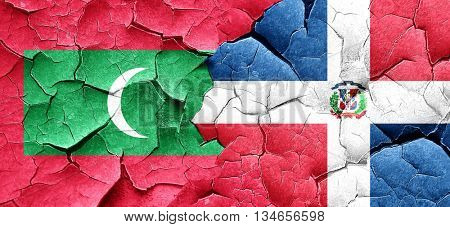 Maldives flag with Dominican Republic flag on a grunge cracked w