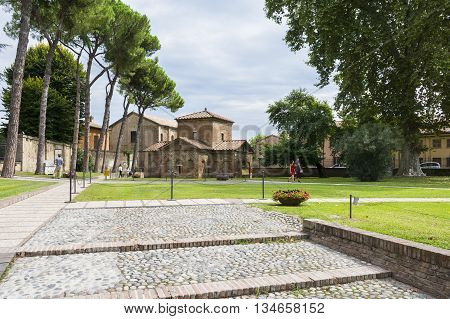 RAVENNA,ITALY-AUGUST 21,2015:view of exterior of Galla Placidia mausoleum from the San Vitale garden's during a cloudy day.
