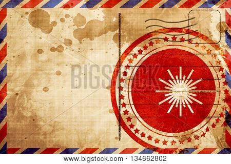 Laser warning sign, red grunge stamp on an airmail background