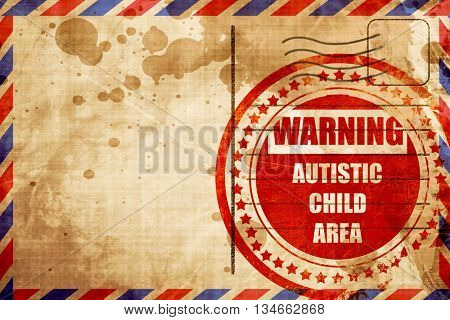 Autistic child sign, red grunge stamp on an airmail background