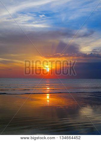 Beautiful sunset sky with reflection at Kuta and Seminyak beach, Bali