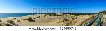 Panorama of sandy dunes and blue sky in the spring morning. Efa Height Curonian Spit National Park Russia.