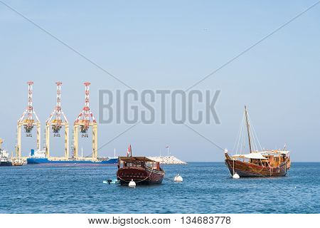 Classic Arabic wooden dhows at the commercial harbour in Muscat Oman.