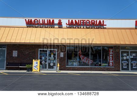 SHOREWOOD, ILLINOIS / UNITED STATES - AUGUST 21, 2015: The Conrad Company sells vacuum cleaners and janitorial supplies in a Shorewood strip mall.