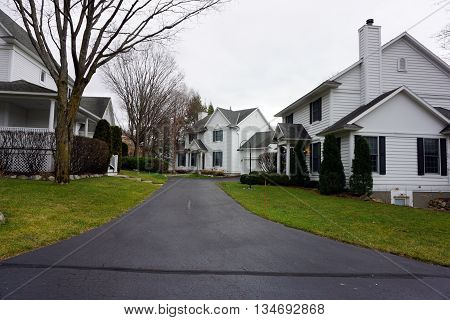 HARBOR SPRINGS, MICHIGAN / UNITED STATES - DECEMBER 24, 2015: Several homes share a common driveway at the end of Fourth Street near downtown Harbor Springs.
