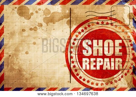 shoe repair, red grunge stamp on an airmail background