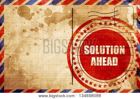 solution ahead, red grunge stamp on an airmail background