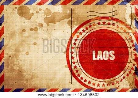 Laos, red grunge stamp on an airmail background