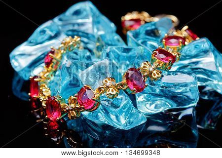 Ruby gold bracelet isolated on black background
